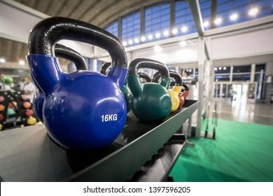 16 kilogram Kettlebells for exercise placed on shelf in gym