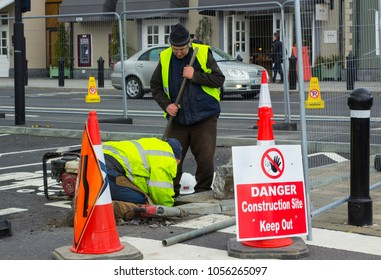 16 March 2018 A couple of workmen carry out essential maintenance repairs at Ireland's Kildare Village retail shopping outlet in County Kildare