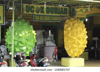 16 March 2019, Medan City, North Sumatra,Indonesia- Ucok Durian with unique durian statues in front of store is one of the most favorite place to eat durian which is the king of fruits in Medan.