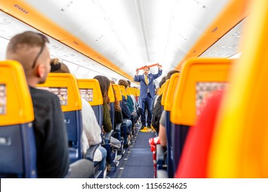 16 MAY 2018, BUDAPEST HUNGARY: Passengers seating and listening to the crew members steward safety instructions inside the Ryanair airlines plane
