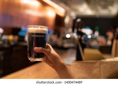 16 May 2019; Bangkok Thailand: Handed Starbucks Nitro Cold Brew at Starbucks Siam Square One Flagship, Starbucks Reserve Cafe Coffee Shop.
