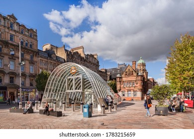 16 September 2015: Glasgow, Scotland - St Enoch Square, with old and new subway entrances.