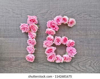 16, sixteen - vintage number of pink roses on the background of dark wood - for congratulations, postcards, websites, design, printing