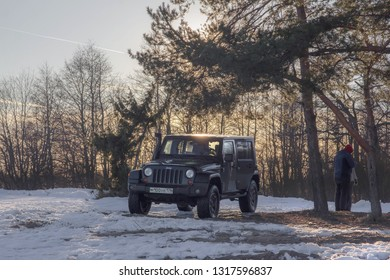16.02.2019. Leningrad region. Russia. Black Jeep Wrangler JK on the Gulf of Finland, Russia