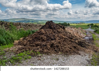 16/06/2019 A Dales High Way between Skipton and Addingham Yorkshire Dales. Manure dumped next to a track