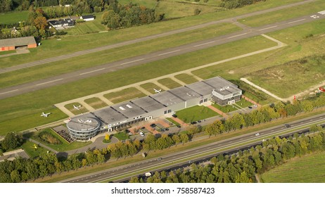 16-10-2017, Etten Leur, Holland. Aerial view of Seppe Breda International Airport. A small airstrip in the province of Noord-Brabant with a restaurant, tower and concrete runway between green fields.