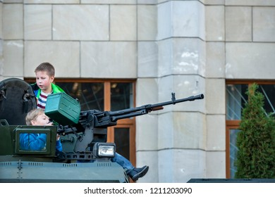 16.10.2018. Zhytomyr, Ukraine, exhibition of military equipment on the central square of the city, children are assimilated and played with machinegun