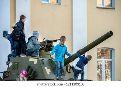 16.10.2018. Zhytomyr, Ukraine, exhibition of military equipment on the central square of the city, children are assimilated and played with weapons
