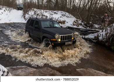 16.12.2017. The Karelian isthmus. Leningrad region. Russia. Jeep Cherokee rides on the water. The jeep Cherokee is a compact SUV manufactured by Chrysler