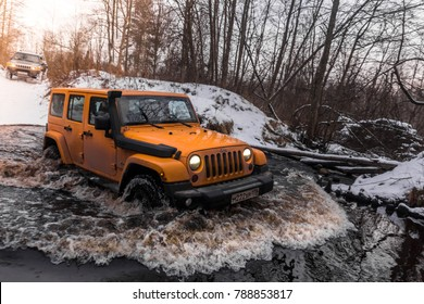 16.12.2017. The Karelian isthmus. Leningrad region. Russia. Jeep Wrangler Rubicon rides on the water. The jeep Wrangler is a compact SUV manufactured by Chrysler