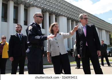16-May-2015 Victoria Nuland, the ambassador of the US in Ukraine and a California Highway patrol policeman checking the skills of the new patrol police recruits in Kyiv, Ukraine