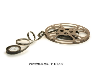 A 16mm film in a metallic reel, isolated over white background, with clipping paths