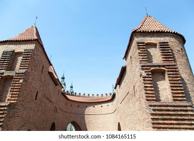 16th century Barbican castle defense wall with towers in Warsaw old town.