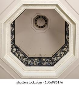 16th century black metal banister seen from below