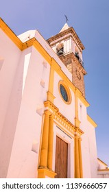 The 16th century church Parroquia de Las Angustias  in Ayamonte, Huelva province, Andalusia, Spain on a bue sky summer day above