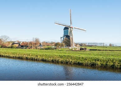 16th century mill situated along a small stream in a Dutch polder.