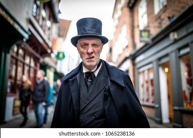 16th February 2018, The Shambles, York. Ghost Tour guide dressed as a menacing Victorian male undertaker sneering at the camera in The UK