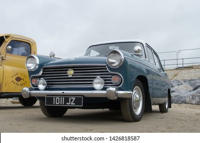 16th June 2019- A classic Morris Oxford four door saloon car parked on the sandy beach at Pendine, Carmarthenshire, Wales, UK.