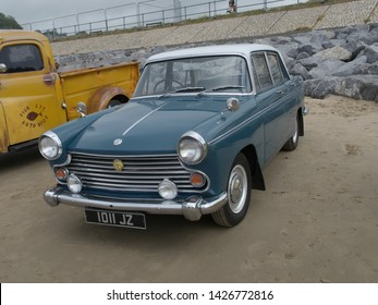 16th June 2019- A Farina styled Morris Oxford four door saloon car, built in 1964, parked on the sandy beach at Pendine, Carmarthenshire, Wales, UK.
