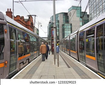 16th November 2018 Dublin. Two Dublin City Luas light rail trams, with the IFSC International Financial Services Centre offices in the background.