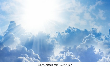 16x9 wide-screen aspect ratio background - light from heaven. Sun and clouds.