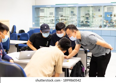 17 11 2020 Professor and Students with face mask and computer have small group teaching and discussion in Classroom in university in Hong Kong during Covid-19