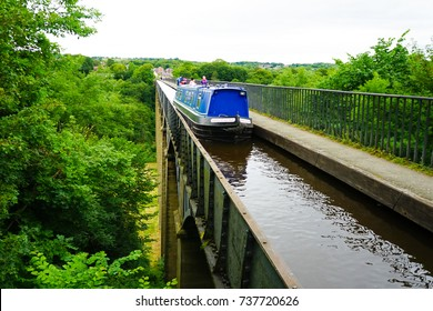 17 Aug 2017 - Wrexham, England. Boats crossing the Pontcysyllte Aqueduct and Canal