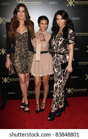 17 August 2011 - Hollywood, California - Khloe Kardasian, Kourtney Kardashian, and Kim Kardashian. Kardashian Kollection Launch Party Held at The Colony. Photo Credit: Kevan Brooks/AdMedia