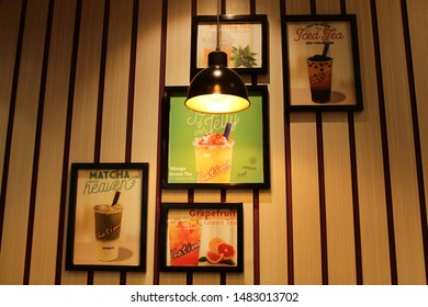 17 August 2019, Medan City, Indonesia- Beautiful wall decor with posters of various kinds of drinks sold by the fresh drink shop
