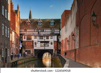 17 February 2015: Lincoln, UK - The High Bridge is the oldest bridge in the UK which still has buildings on it. It was built in 1160, and the row of shops above was built in 1550.