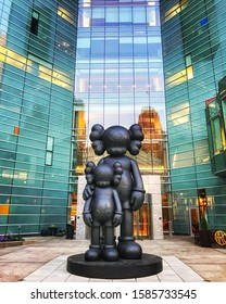 "The 17 foot statue titled ""Waiting"" by Kaws in front of the Compuware Building on Campus Martius in Detroit Michigan June 2018."