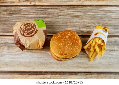 17 January 2020 Chicago IL: Burger king set has hamburger french fries on wooden table