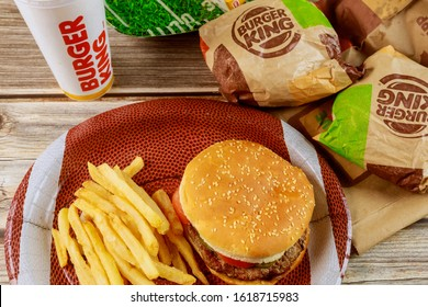 17 January 2020 Chicago IL: Burger King French fries and cola in wooden table