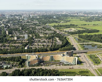 17 July 2017, Amstelveen, Holland. Aerial view of the headquarters of KPMG along highway A9. KPMG is a legal consulting company. On the clear horizon the city of Amsterdam