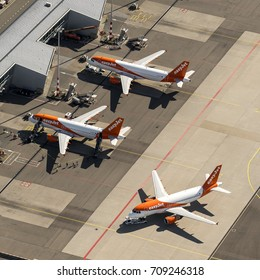 17 July 2017, Amsterdam Airport, Holland. Aerial view of three planes of lowcost carrier Easyjet are at the M gate at Schiphol Airport in the Haarlemmermeer near Hoofddorp. One jet is just taxing out.