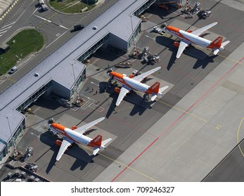 17 July 2017, Amsterdam Airport, Holland. Aerial view of three planes of lowcost carrier Easyjet are at the M gate at Schiphol Airport in the Haarlemmermeer near Hoofddorp