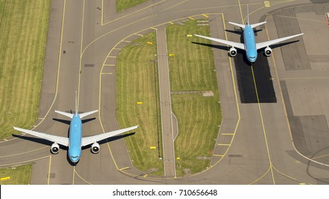 17 July 2017, Haarlemmermeer, Holland. Aerial view of two KLM Royal Dutch Airlines Boeing 777 on the taxi way next to each other at Schiphol Amsterdam Airport .