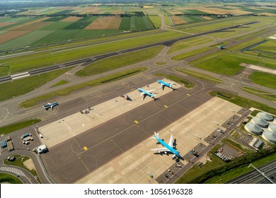 17 July 2017, Hoofddorp, Holland. Aerial view of runway Zwanenburgbaan at Schiphol Amsterdam Airport. Planes of KLM Royal Dutch Airlines and TUI are on the platform and the taxi way.