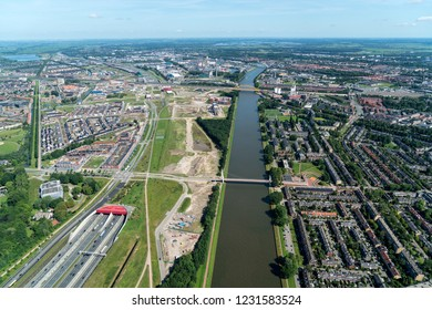17 July 2017, Utrecht, Holland. Aerial view of the new bridge Dafne Schippers Brug over the canal Amsterdam-Rijnkanaal. On the left the A2 highway tunnel and on the right residential area Oog in Al.