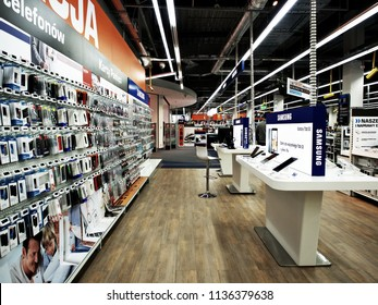 17 July 2018, Avenida poznan, Poland, Shop for mobile, a display of plastic mobile phone cases on shelves, Showcase with smartphones in the modern electronics store. Buy a mobile phone.