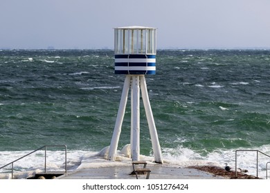 17 Mar, 2018. Klampenborg, Denmark. Lifeguard watch tower designed 1933 by Danish star architect Arne Jacobsen. Rough weather.