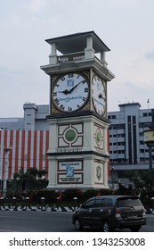 17 March 2019, Medan City, North Sumatra, Indonesia- Iconic wall clock monument of Medan city sponsored by Medan City government and long established newspaper company.