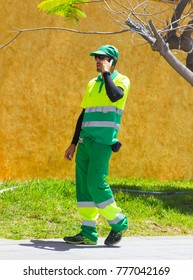 17 May 2017 Los Cristianos Teneriffe A local environmental council worker on a mobile phone