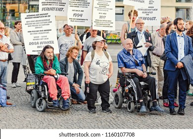 17 MAY 2018, BERLIN, GERMANY: Disabled participants on a wheelchairs of the LGBT rally on the central street of the Berlin city. Gay and transsexual activists protest against repressions in Europe