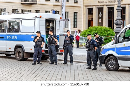17 MAY 2018, BERLIN, GERMANY: Squad of Police near transportation car in center of Berlin