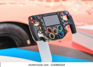 17 MAY 2018, BERLIN, GERMANY: Steering of competition car, gamepad race simulator