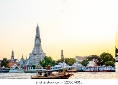 17 November 2018 , 05:30 pm. Bangkok , Thailand. The royal temple next to the main river , Chao Phraya in Bangkok with lots of tourist waiting to travel by boats in the river.