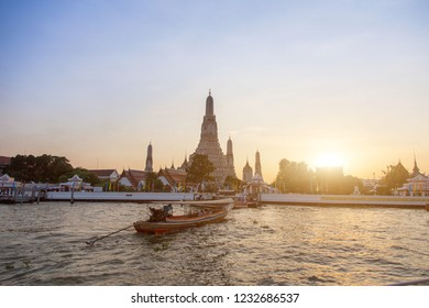 17 November 2018,Bangkok,Thailand. Riverside livestyle of Thai people transis with boat , Buddha temple religion.