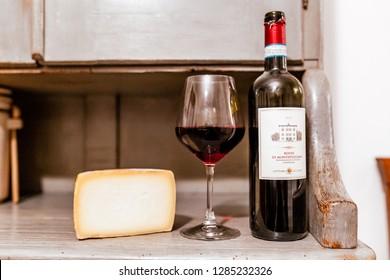 17 OCTOBER 2018, MONTEPULCIANO, ITALY: Bottles of Montepulciano wine with italian cheese