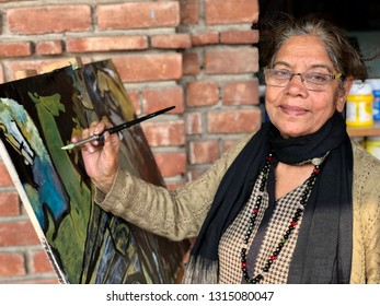 17-02-2019,Delhi Haat , pitampura, New Delhi, India-Modern Arts painter JASVEER KAUR ARORA is influenced by artists m.f. husain and makes painting on subjects like them
